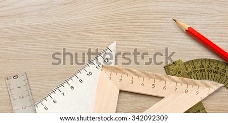 Drafting wooden and steel tools with pencil in closeup - stock photo