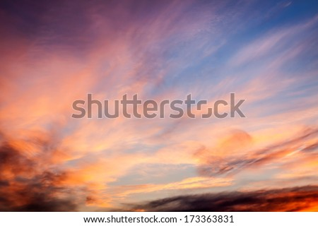 Dramatic sunset sky with orange colored clouds.  - stock photo