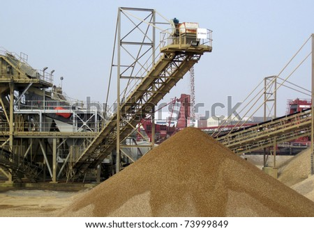 Dredger discharging grit for winter road conditions - stock photo