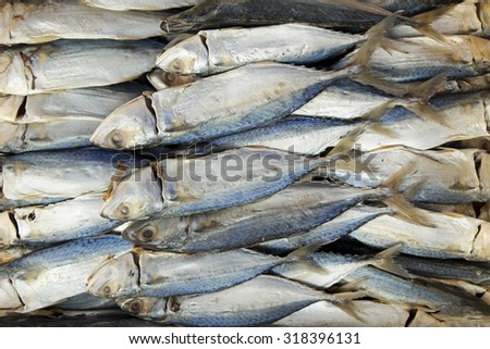 Dried or salted fish selling at local sunday market. Selective focus with shallow depth of field. - stock photo