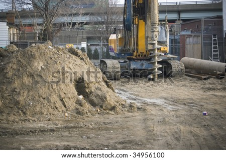 drilling machine on construction site / industrial background