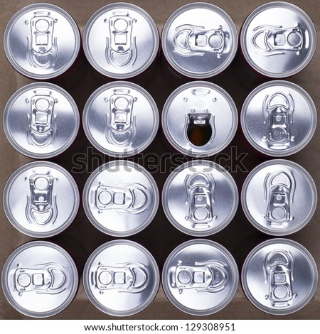 16 drink cans with one opened. Top view. - stock photo