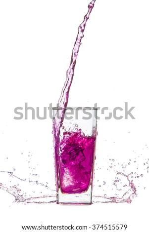 Drink pink splash out of glass. On a white background.   - stock photo