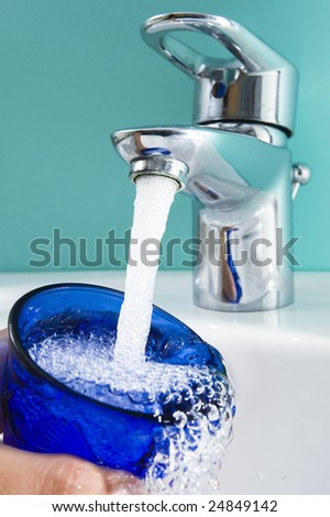 drinking potable water from city pipeline. Water getting sparse. - stock photo