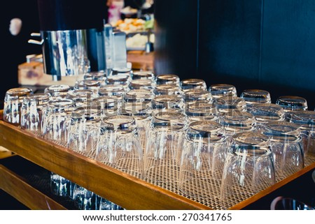 drinking water glass on table - stock photo