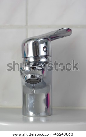 dripping water from metal tap - stock photo