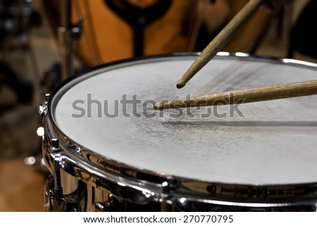 Drum sticks hitting the drum closeup - stock photo