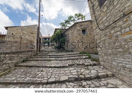 _DSC1925-2Narrow stairway street passage between stonemasonry buildings fisheye view. Pano Lefkara, Cyprus.  - stock photo