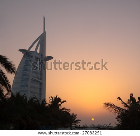 DUBAI, UAE - FEB 23: The Burj al Arab Hotel is shown during a sunset on Feb 23, 2009 in Dubai. At 321 metres (1,053 ft), the hotel was built on an artificial island. - stock photo