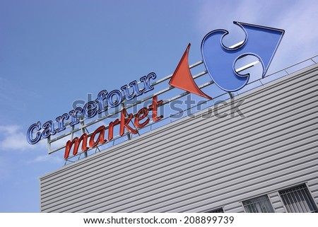 DUCEY, FRANCE - JULI 23: Brand name on facade of a Carrefour market, Carrefour is a French multinational retailer, one of the largest hypermarket chains in the world, on July 23 2014 in Ducey, France - stock photo