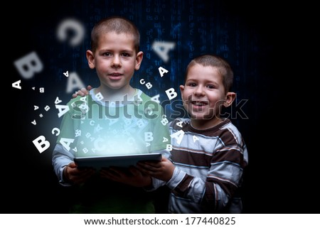 E-learning concept. Boys using digital tablet - stock photo