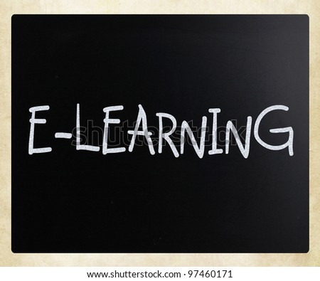 """E-learning"" handwritten with white chalk on a blackboard - stock photo"