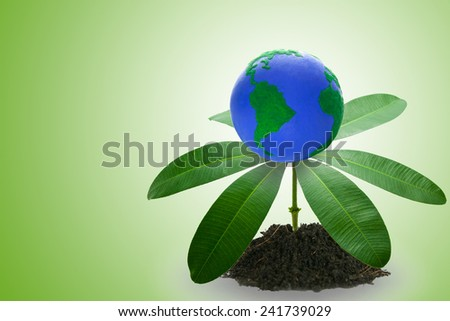 Earth on Green Leaf . Elements of this image furnished by NASA  - stock photo