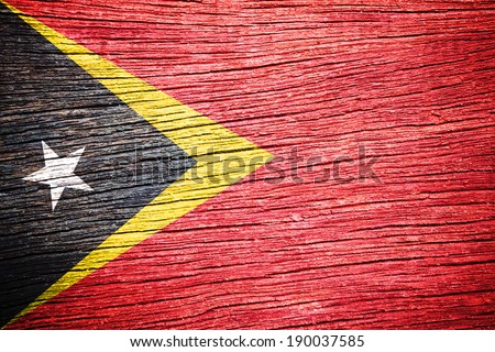 East Timor Flag painted on old wood background
