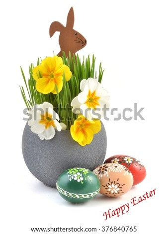 Easter. Easter bunny. Easter background with easter eggs and flowers. Copy space, for easter text. Easter card, easter flower. Easter eggs for easter nest. Easter decoration. - stock photo