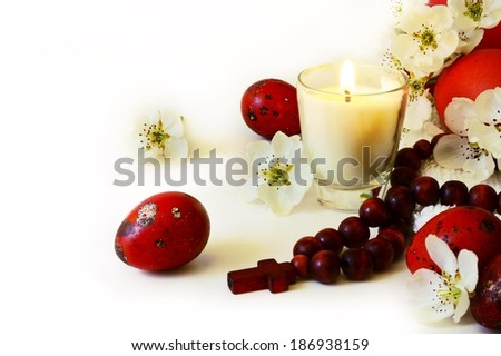 Easter eggs with candle and rosary