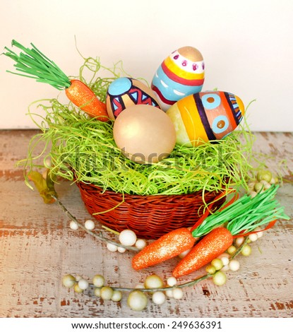 Easter nest with eggs over a wood background. - stock photo