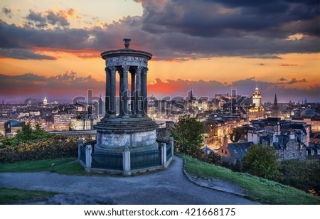 Edinburgh against sunset with Calton Hill in Scotland - stock photo