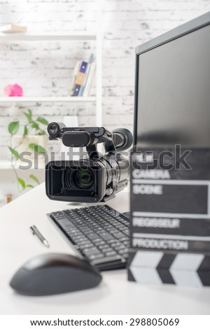 editing video computer and movie camera - stock photo