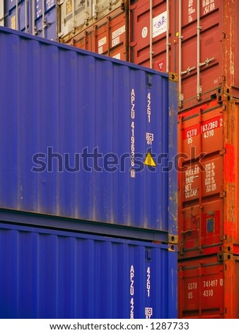 (Editorial/News) Close-up of overseas shipping containers stacked in a loading area. - stock photo