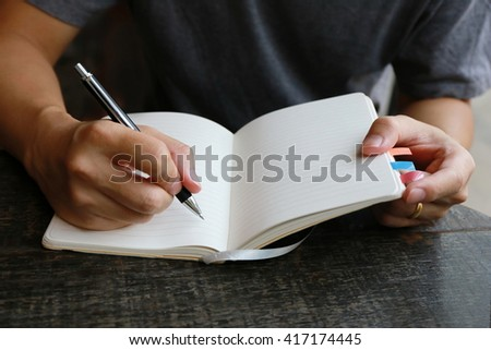 education concept, man hand note on notebook - stock photo