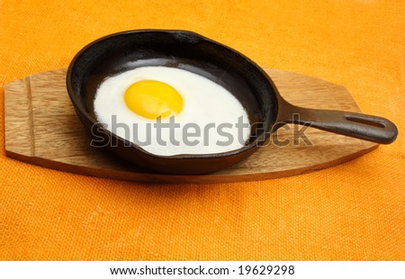 egg in a black cast iron pan