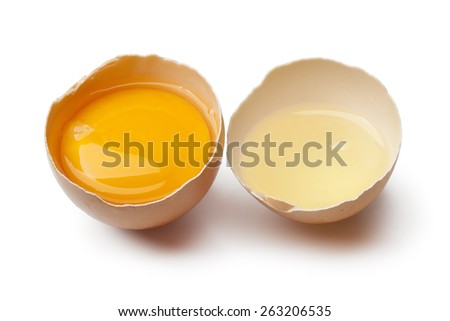 Egg yolk and white in a broken brown egg shell on white background - stock photo