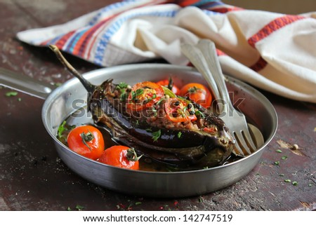 Eggplant stuffed with meat and assorted vegetables - stock photo
