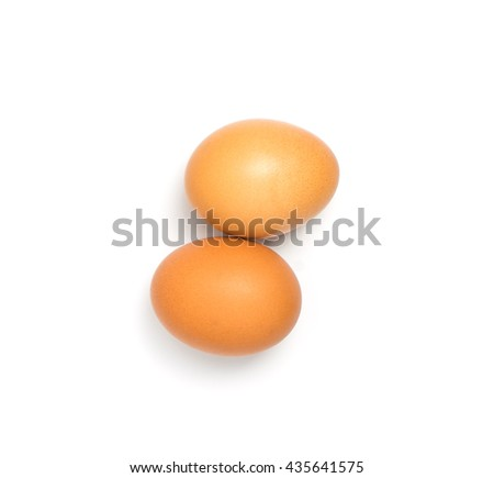 2 Eggs aligning on white background. a