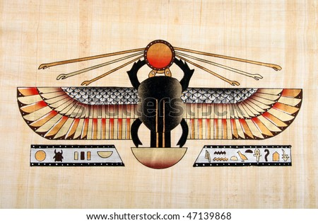 Egyptian papyrus with  winged scarab beetle - stock photo