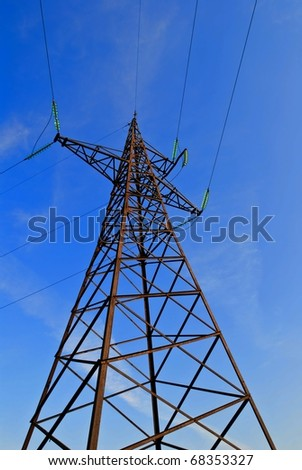 electric mast  on a blue sky background