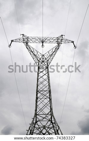 Electric power utility pole on cloudy sky - stock photo
