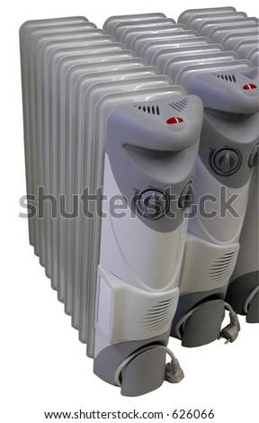3 electric radiators on isolated background - stock photo