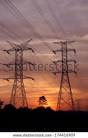 Electric towers and sunset - stock photo