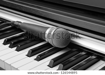 Electronic keyboard and microphone - stock photo