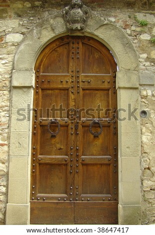 elegant entrance with family coat in Tuscany, Italy - stock photo