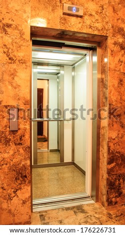 Elevator into a building with open door
