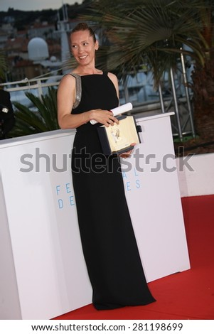 Emmanuelle Bercot attends a photocall for the winners of the Palm D'Or during the 68th annual Cannes Film Festival on May 24, 2015 in Cannes, France. - stock photo