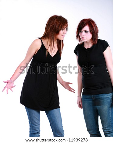 2 emo girls with messy hair and makeup fighting - stock photo