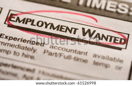 """Employment wanted"" circled in red on newspaper. - stock photo"