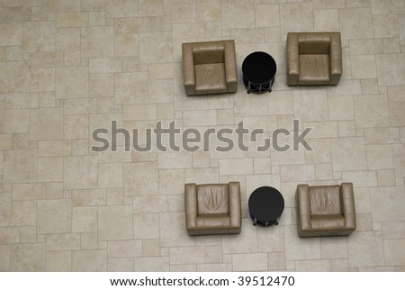 4 empty armchairs in the meeting place waiting to be occupied - stock photo