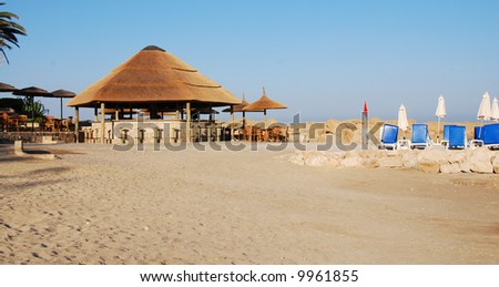 Empty Beach with a Pavilion from a hotel at Paphos area , - Cyprus - stock photo