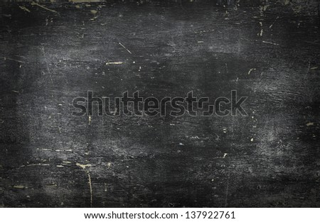 Empty blank black chalkboard with chalk traces - stock photo