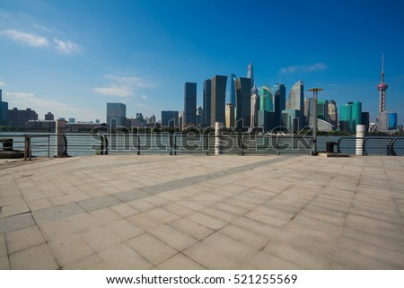 Empty road floor surface with modern city landmark buildings in Shanghai skyline