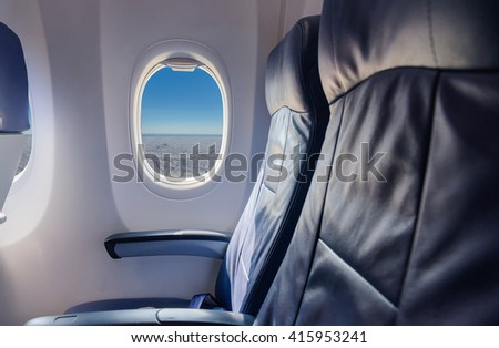 empty seat  airplane and window view inside an aircraft