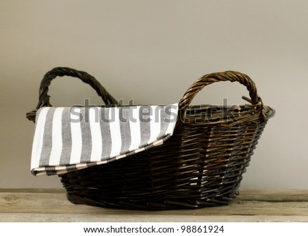 empty wicker basket on a gray background - stock photo
