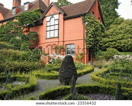 English Country House and Garden with box hedging and path