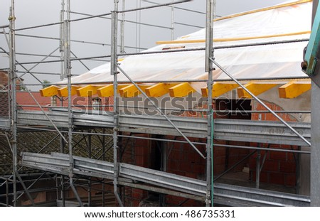 erect scaffolding in residential construction site