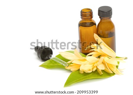 Essential aroma oil with champaka flower - stock photo