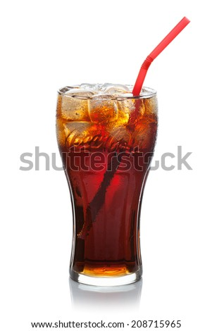 ESTONIA-JULI 09, 2014.Coca-Cola with ice cubes and straw in a glass. Coca-Cola Company is the leading manufacturer of soda drinks in the world. Illustrative editorial photo. - stock photo